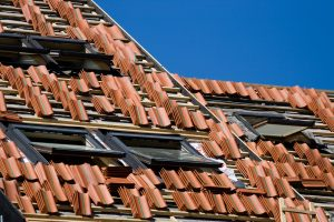 Red tile roof repair or construction work in progress